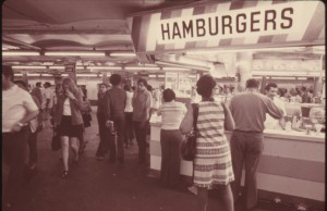 HAMBURGER STAND OFFERS CUSTOMERS A QUICK BITE WHILE WAITING FOR THEIR SUBWAY TRAIN ON THE 42ND STREET STATION, NARA.  Wikimedia Commons